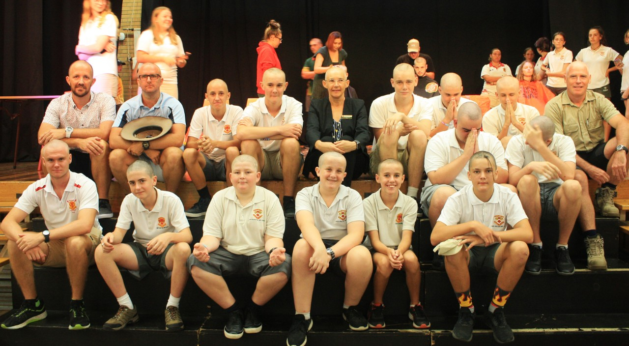 Students and staff with shaved heads